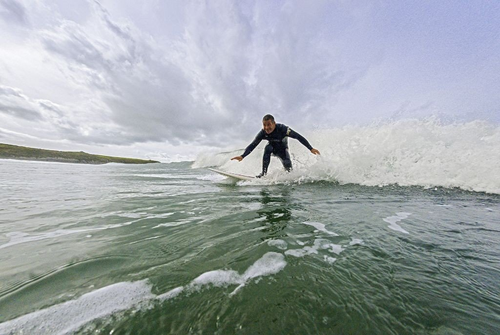 Wales Travel: Surfer riding wave. Whitesands Bay Near St David's Pembrokeshire South © Crown copyright (2014) Visit Wales