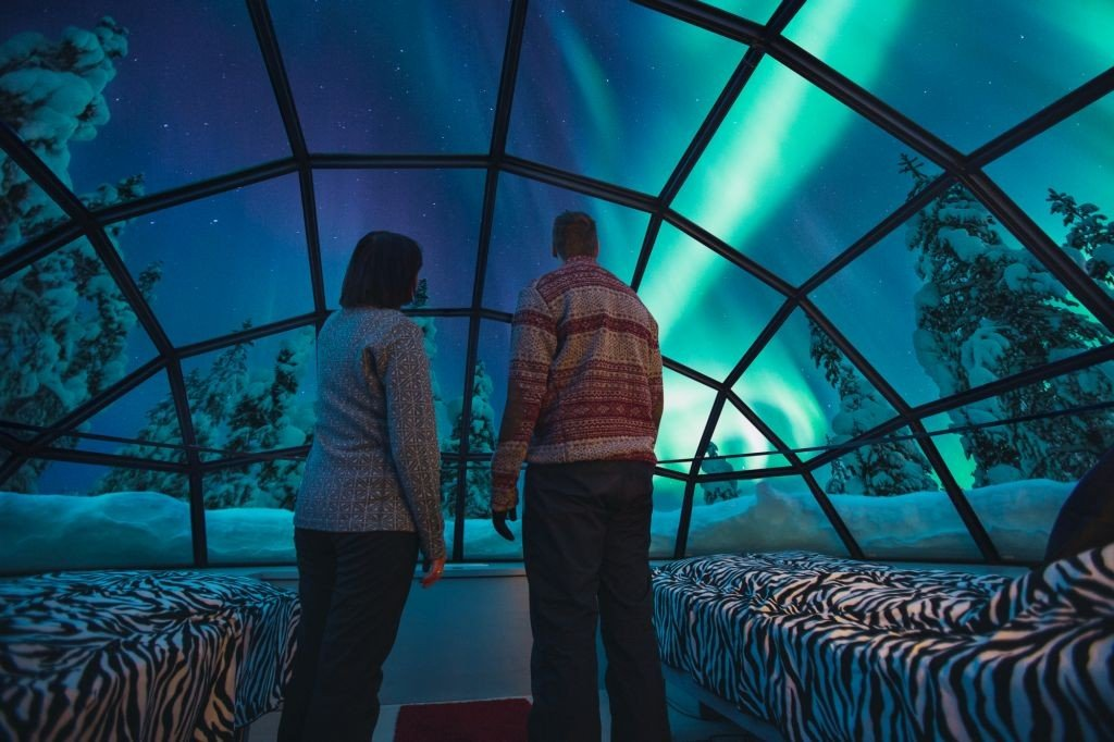 Kakslauttanen glass igloo inside Northern Lights Finland