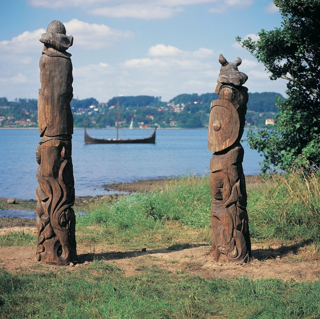 Viking ship and Viking monuments at Vejle Fjord. Photo: Cees van Roeden/ Visit Denmark