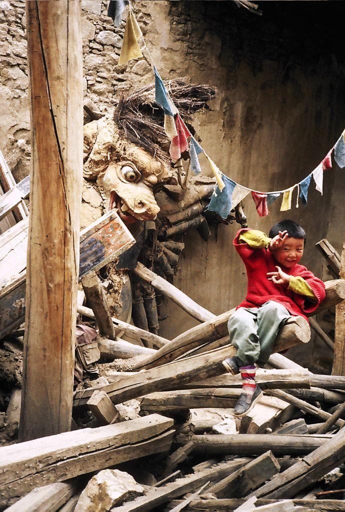 Child in broken down Tibetan Temple