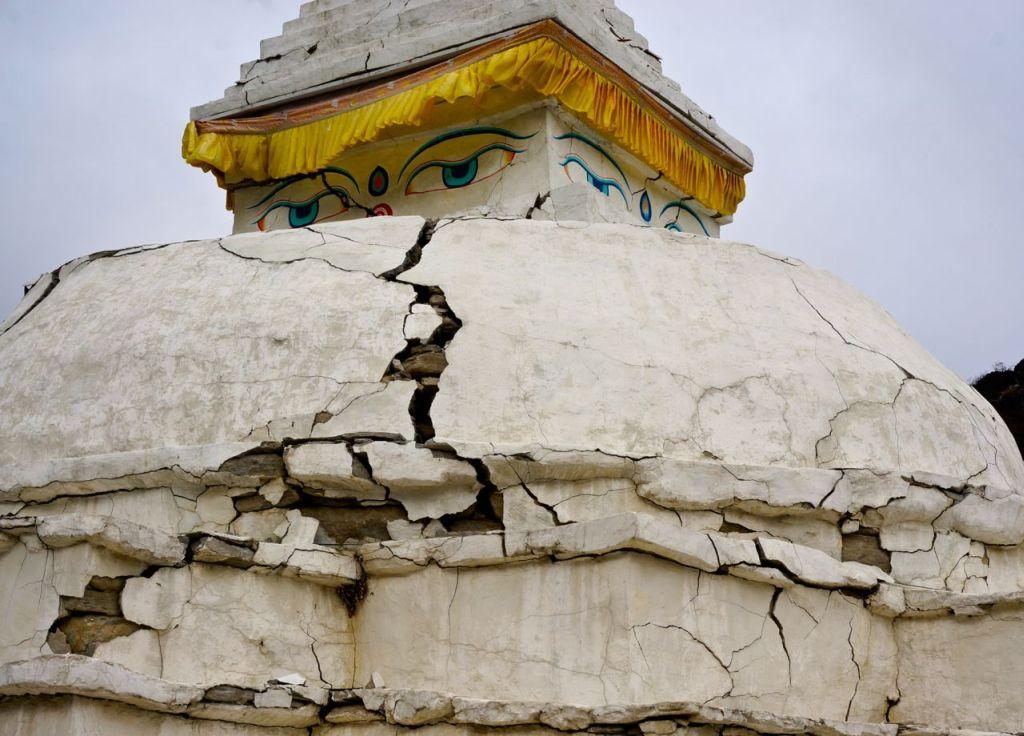 Eyes of Buddha on an earthquake-cracked stupa in Nepal's Khumbu region