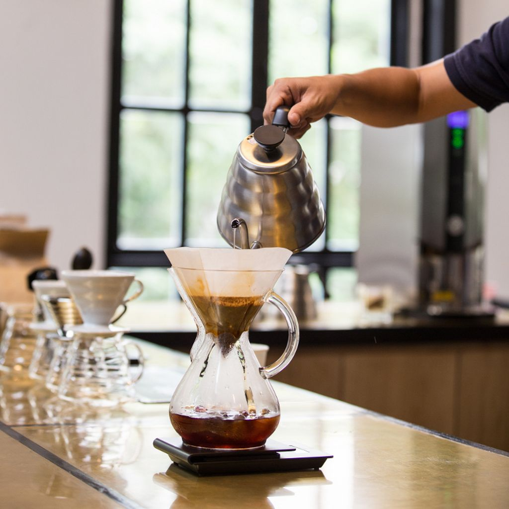 Watch the baristas prepare coffee using different brewing methods at The Workshop. Photo by: City Pass Guide