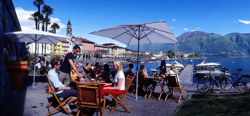 Coffee Break on the Piazza of Ascona, with view on the Lago Maggiore, Ticino. Photo: Ticino Turismo /Christof Sonderegger