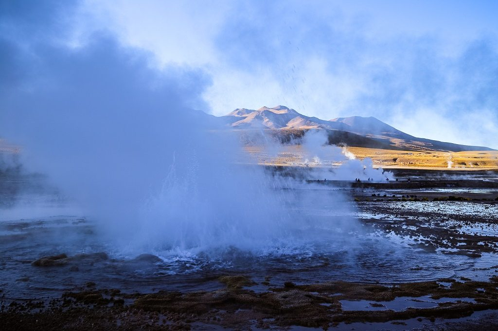 The eerie thermal landscape at El Tatio brightens as the sun rises and the geysers settle to a slow simmer