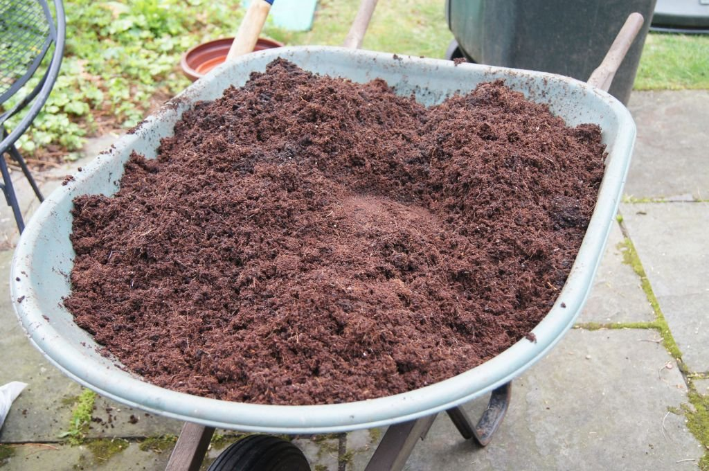 Wheelbarrow full of the finished potting mix soil