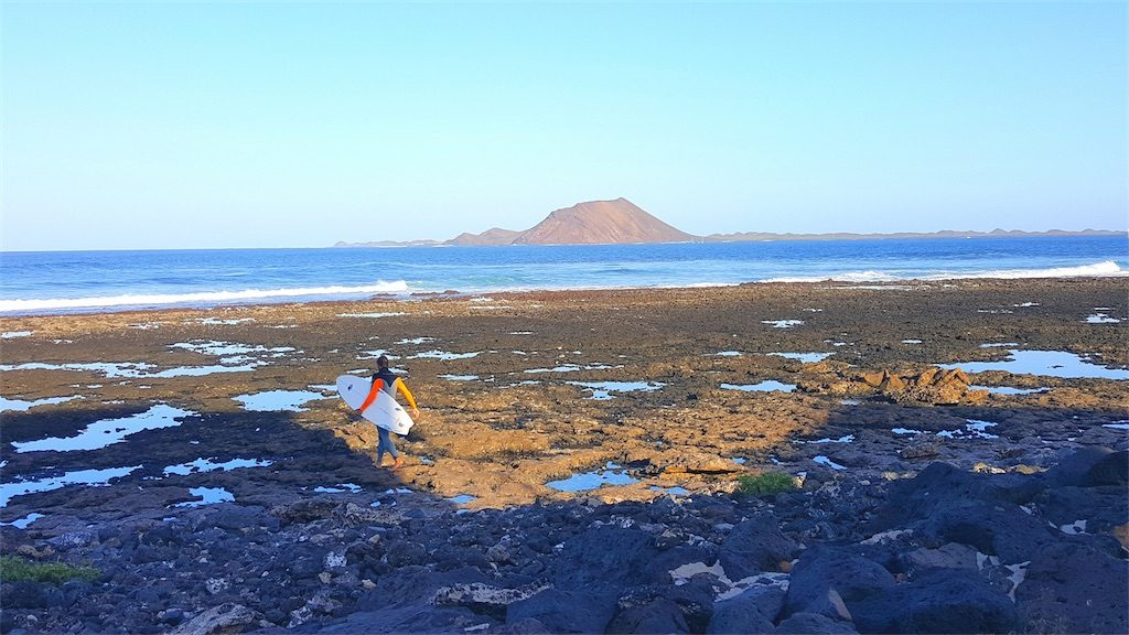 Fuerteventura surfer on beach