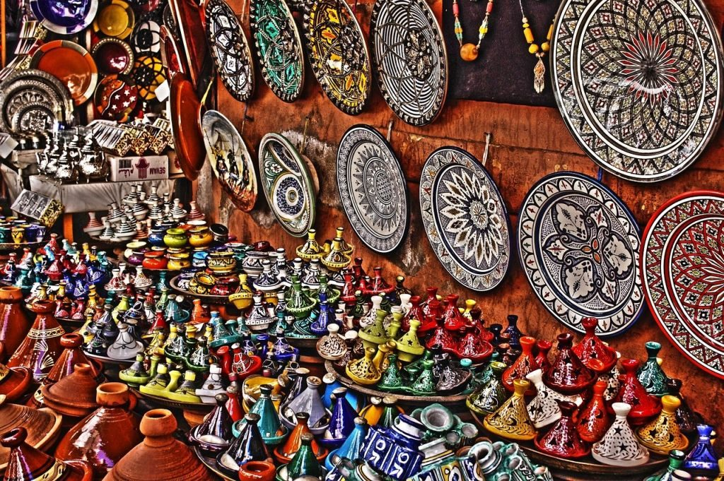 Tajine pots in a colourful souk in Morocco