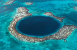 Aerial view of the Blue Hole, collapsed cavern, now submerged, Lighthouse Atoll. Belize