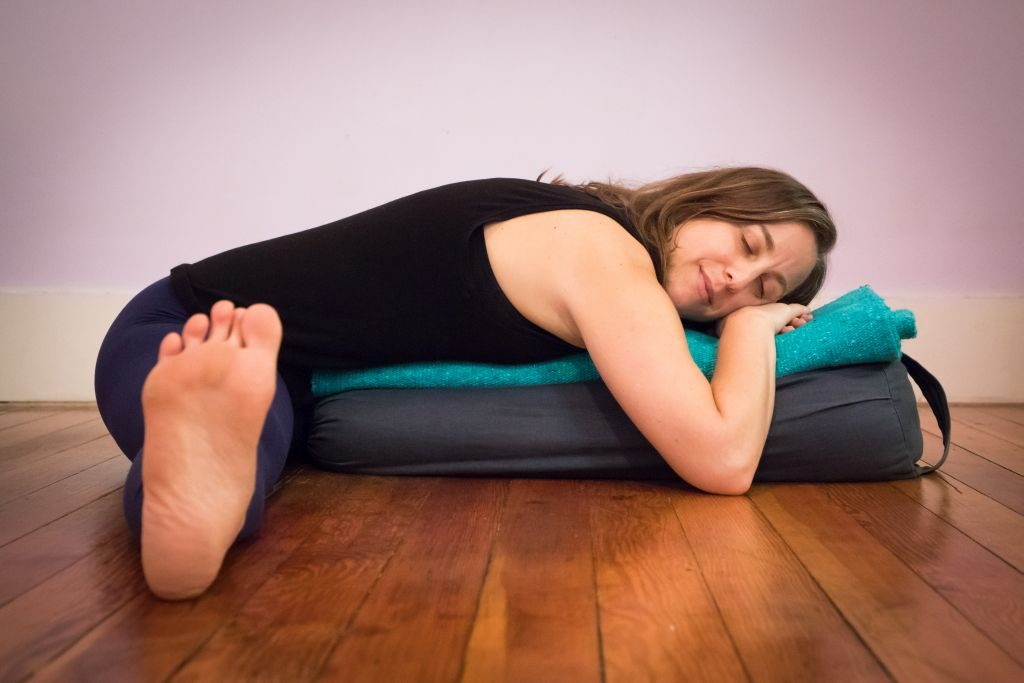 Yoga Teacher Estee Fletter doing restorative forward bend - 1024 x 683