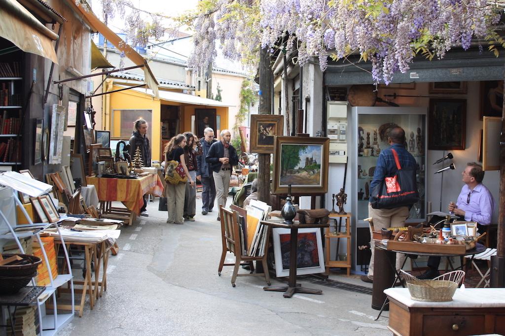 Porte de Clignancourt Market where visitors look at antiques
