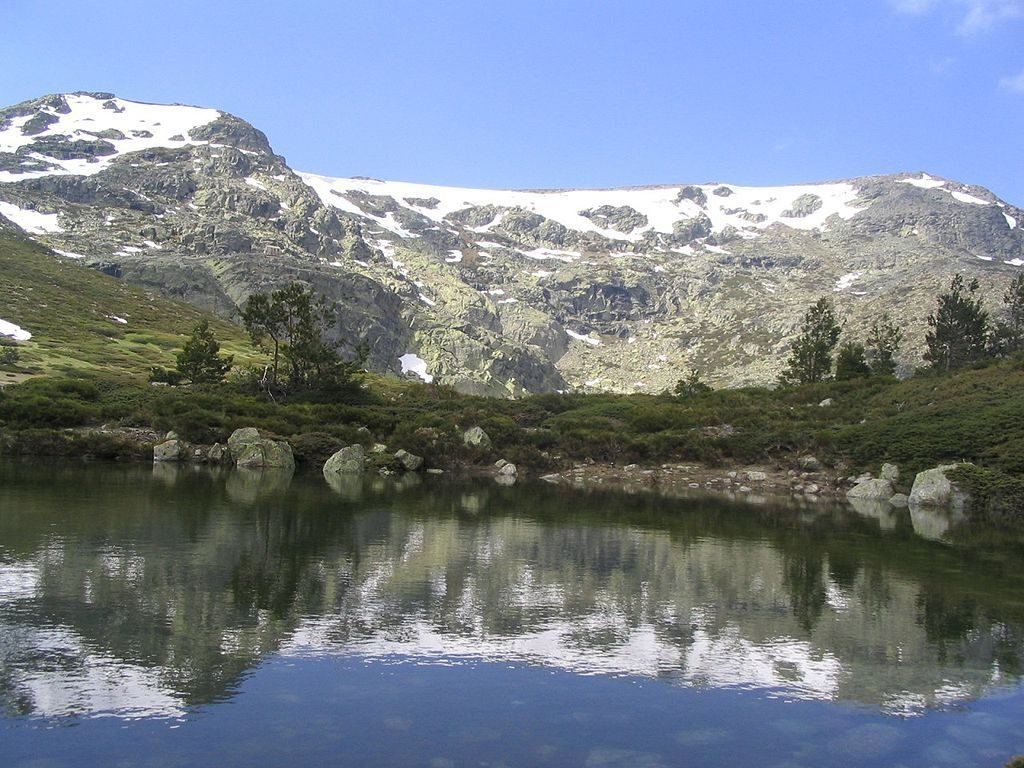 View of the Peñalara and its reflection in the Small Lake spain