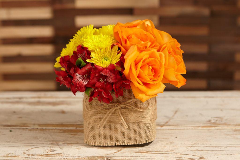 flowers in burlap vase