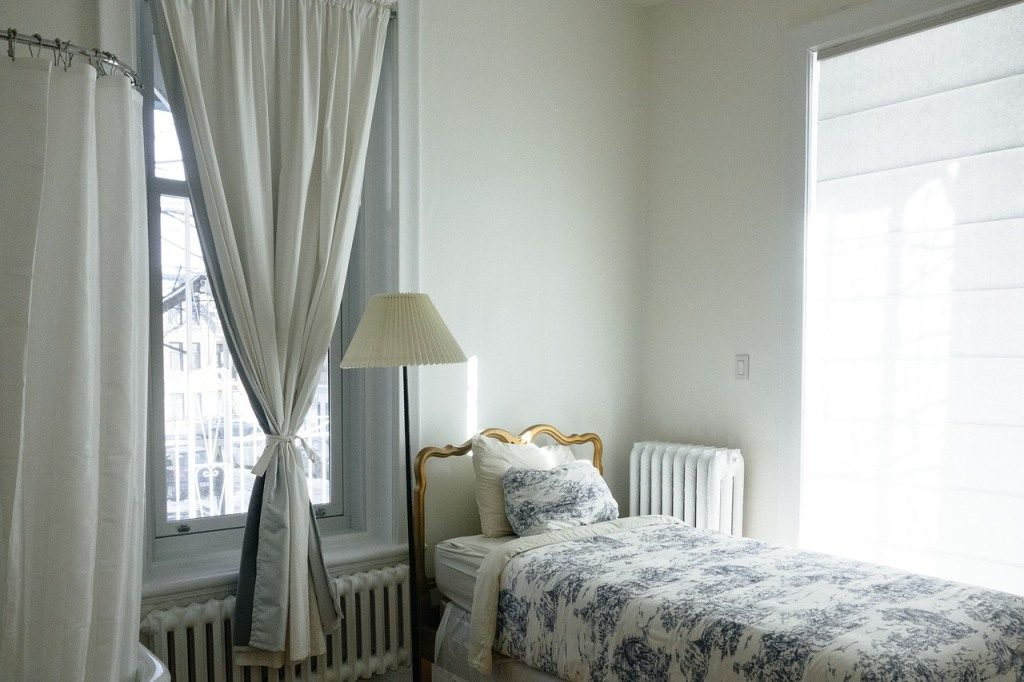 Room in white and blue with closed blinds