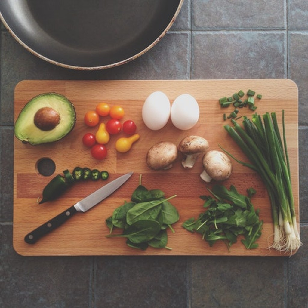 Cooking board with knife, eggs, avocado, mushrooms, etc wellness tips