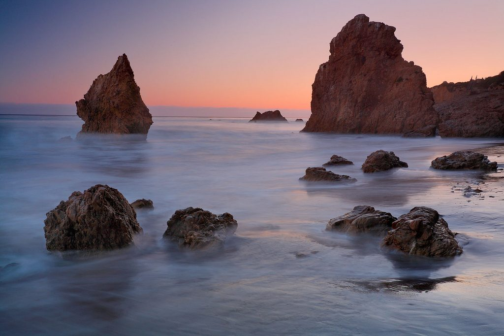 American beach in Malibu, California. Low tide, rocks, and a sunset. El Matador State Beach.