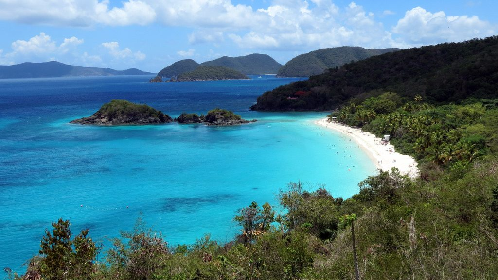 White sand, pristine blue water, green mountains, and the American territory of Trunk Bay in the US Virgin Island of St John