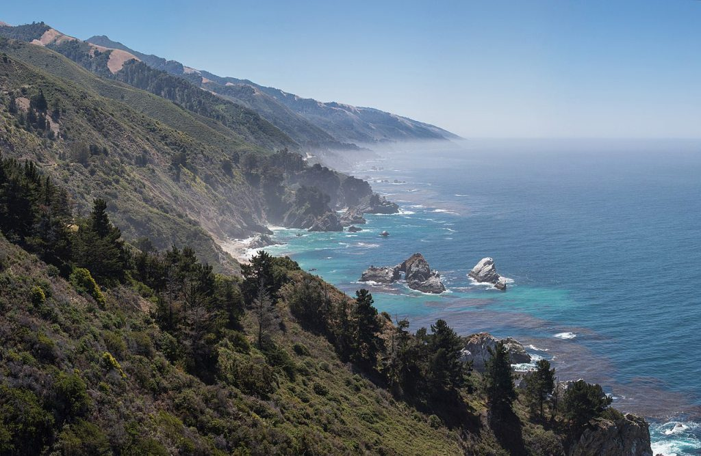 Central Californian coastline looking south, with the McWay Rocks (with arch) in the foreground, and McWay Cove in the center