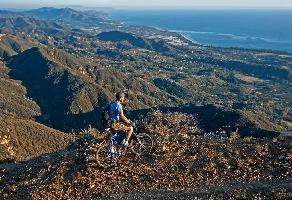 Mark Weber mountain biking the Romero Road Trail high above the Pacific Ocean and the city of Santa Barbara in the Santa Ynez Mountains in southern California