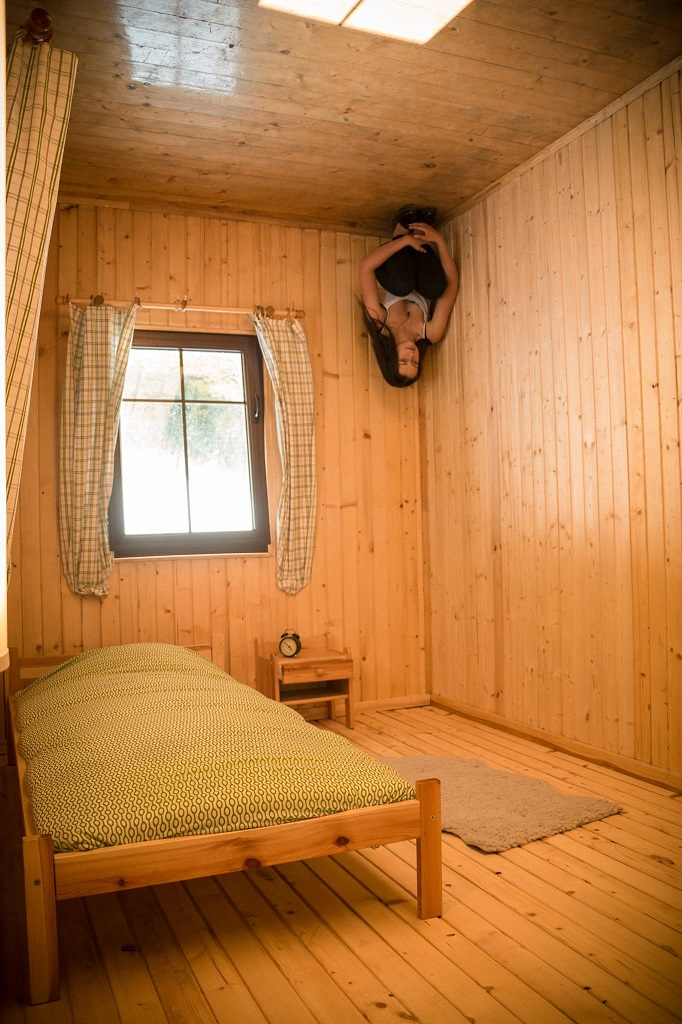 Upside Down House - bedroom person in corner UK bournemouth