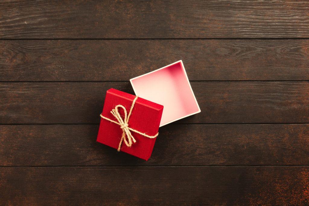 Red cardboard box on wood