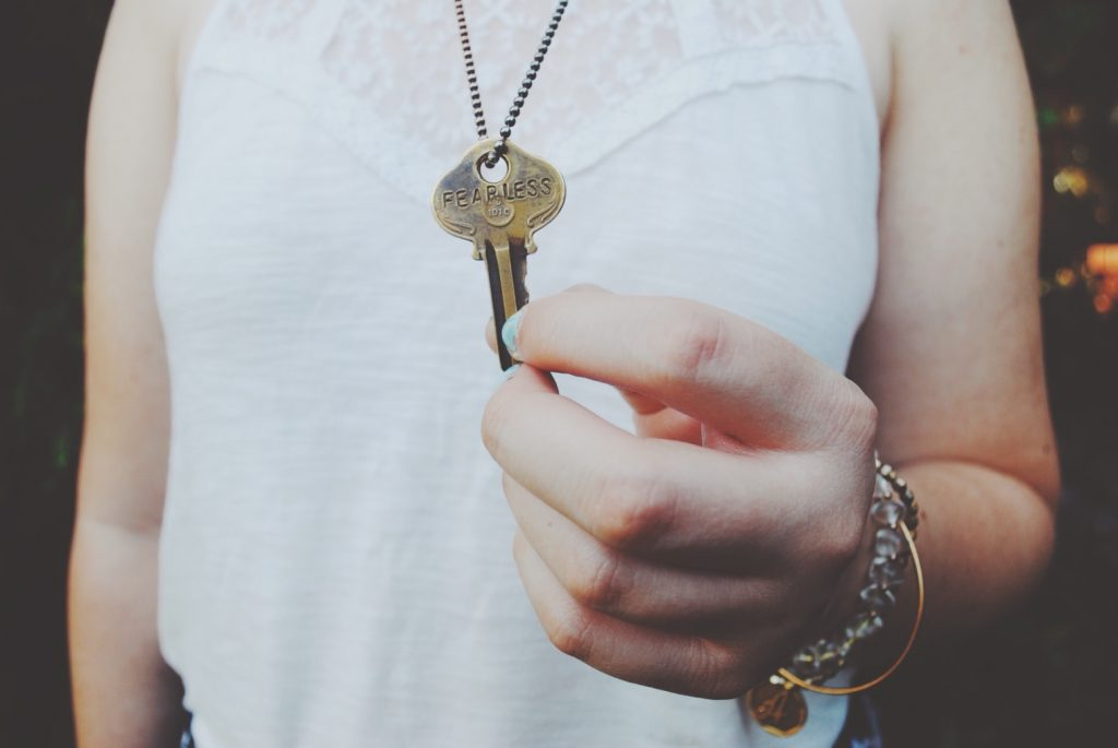 Woman holding old key
