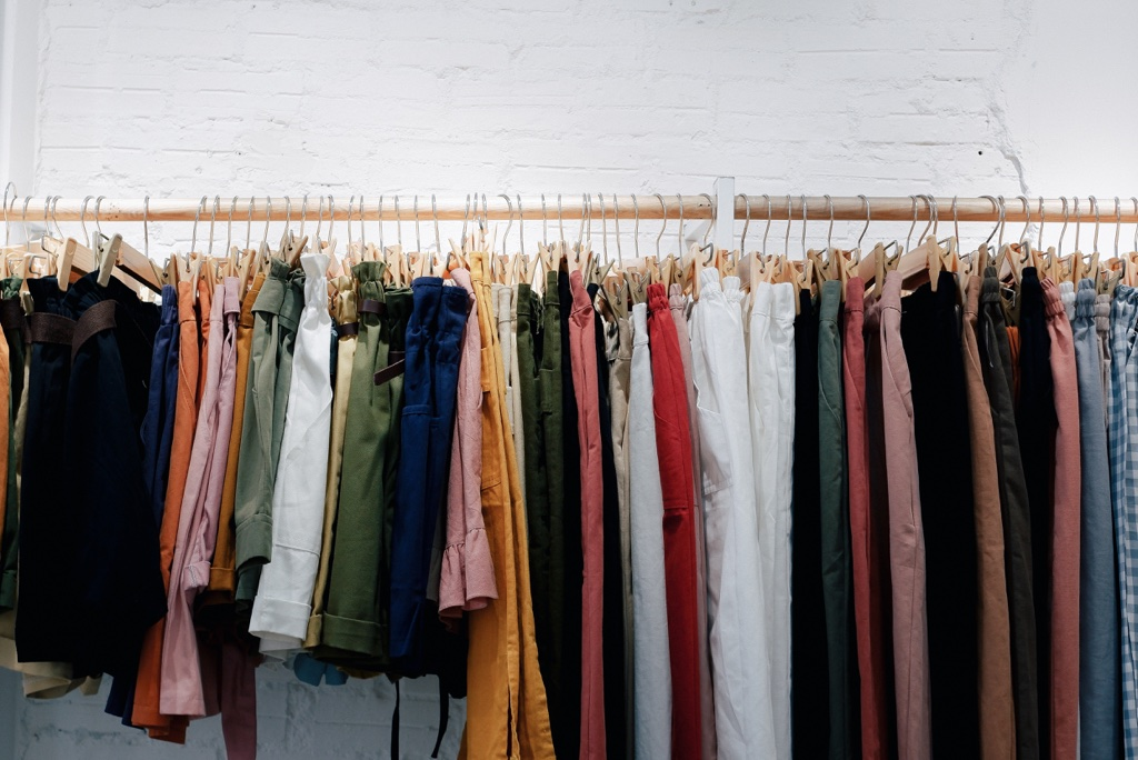 a colorful rack of clothes