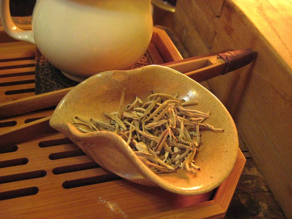 White Tea Leaves and tea pot