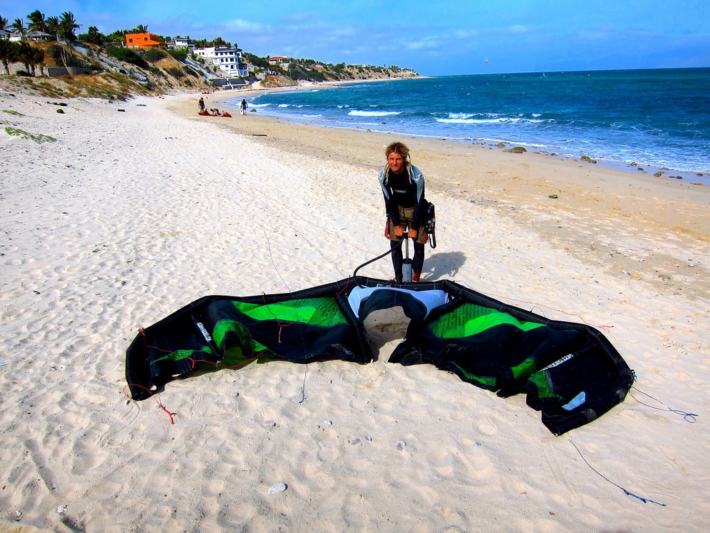 A kite surfer getting ready for his ride on the beach of la ventana