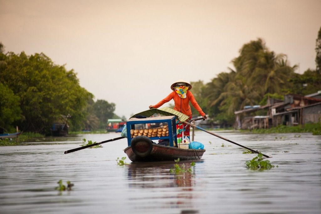 Boater along the Mekong Delta
