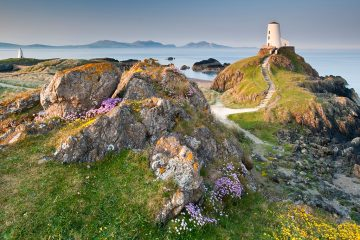 Twr Mawr Lighthouse backed by Lleyn Peninsula, Llanddwyn Island, Newborough, Anglesey, North Wales best trips of 2020
